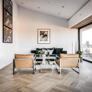 Bild på ett minimalistiskt vardagsrum, med ett finrum, vita väggar, ljust trägolv och grått golv