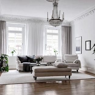 Inspiration för stora minimalistiska separata vardagsrum, med ett finrum, vita väggar, mellanmörkt trägolv och brunt golv