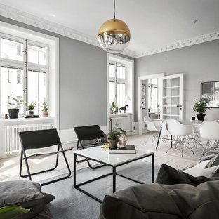 Inspiration for a large scandi formal open plan living room in Stockholm with grey walls, light hardwood flooring, no fireplace and no tv.