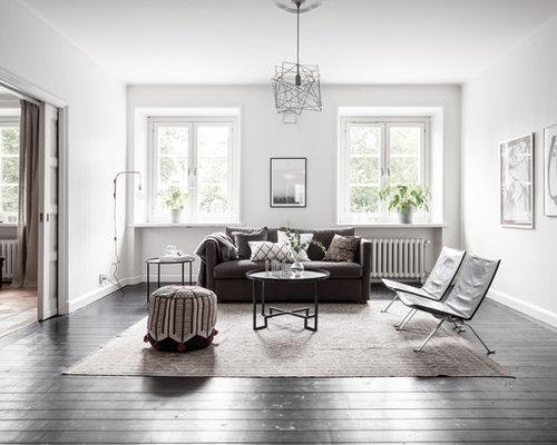 Foton och inredningsidéer för separata vardagsrum, med mörkt trägolv