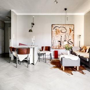 Inspiration för mellanstora nordiska allrum med öppen planlösning, med målat trägolv, grå väggar och grått golv