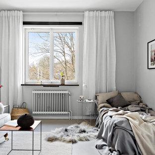 Idéer för nordiska separata vardagsrum, med grå väggar, betonggolv och grått golv