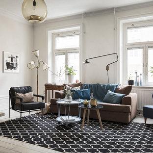 Inspiration för mellanstora skandinaviska separata vardagsrum, med vita väggar, ljust trägolv och beiget golv