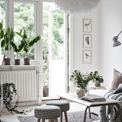 Inspiration for a mid-sized scandinavian formal light wood floor living room remodel in Gothenburg with white walls and no tv