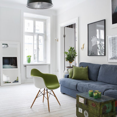 Inspiration for a large scandinavian open concept painted wood floor living room remodel in Stockholm with white walls, no fireplace and no tv