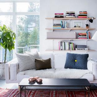 Foto di un soggiorno nordico di medie dimensioni e aperto con sala formale, pareti bianche, pavimento in pietra calcarea, nessun camino e nessuna TV