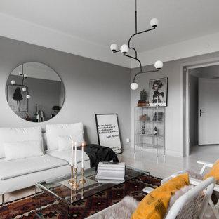 Bild på ett skandinaviskt separat vardagsrum, med grå väggar, ljust trägolv och beiget golv