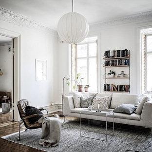 Inspiration för ett minimalistiskt separat vardagsrum, med vita väggar, mörkt trägolv och brunt golv