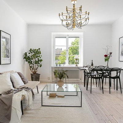 Living room - mid-sized scandinavian open concept and formal light wood floor living room idea in Stockholm with white walls