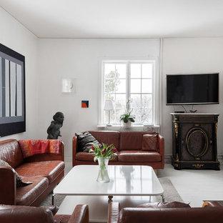 Inspiration för minimalistiska separata vardagsrum, med vita väggar, en standard öppen spis, en väggmonterad TV och vitt golv