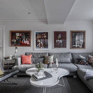 Modern inredning av ett mellanstort separat vardagsrum, med vita väggar