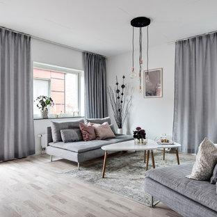 Idéer för ett nordiskt separat vardagsrum, med vita väggar, ljust trägolv, beiget golv och ett finrum