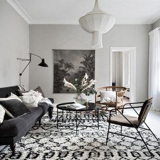 Idéer för att renovera ett nordiskt vardagsrum, med grå väggar, målat trägolv och vitt golv
