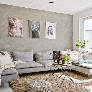Bild på ett skandinaviskt vardagsrum, med grå väggar