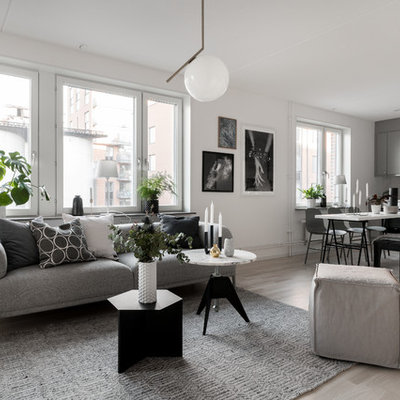 Inspiration for a mid-sized scandinavian formal and open concept light wood floor and beige floor living room remodel in Stockholm with white walls