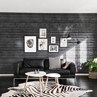 Exempel på ett stort skandinaviskt allrum med öppen planlösning, med svarta väggar, svart golv och mörkt trägolv