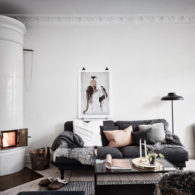 Living room - mid-sized scandinavian formal and open concept light wood floor living room idea in Gothenburg with white walls and no tv