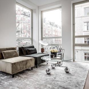 Idéer för ett mellanstort modernt vardagsrum, med vita väggar, ljust trägolv och beiget golv