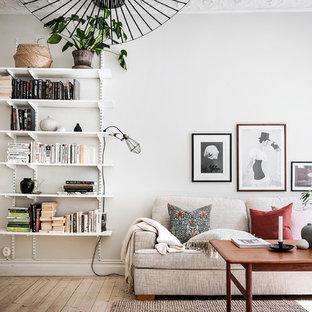 Idéer för mellanstora nordiska separata vardagsrum, med vita väggar, ljust trägolv och beiget golv