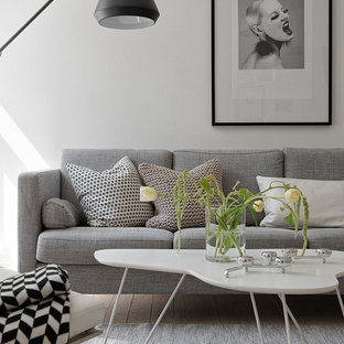 Example of a trendy formal light wood floor living room design in Gothenburg with white walls and no fireplace