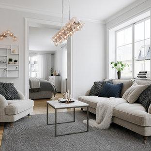 Inspiration för ett minimalistiskt vardagsrum, med grå väggar, mellanmörkt trägolv, en väggmonterad TV och brunt golv