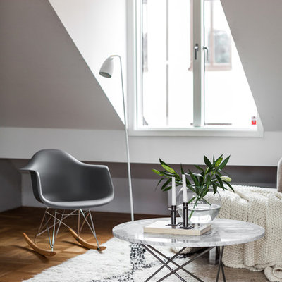 Living room - mid-sized scandinavian formal and open concept light wood floor living room idea in Stockholm with white walls, no fireplace and no tv