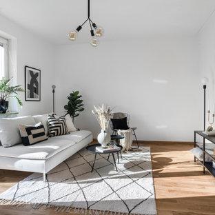 Inspiration för mellanstora skandinaviska allrum med öppen planlösning, med ett finrum, vita väggar, mellanmörkt trägolv och brunt golv