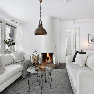 Foto på ett nordiskt separat vardagsrum, med vita väggar