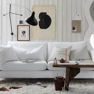 Idee per un soggiorno nordico di medie dimensioni con pareti bianche, moquette e pavimento bianco