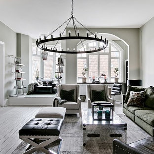 Idéer för ett mellanstort minimalistiskt separat vardagsrum, med ljust trägolv, beiget golv, grå väggar och en fristående TV