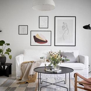 Inspiration för skandinaviska vardagsrum, med vita väggar och vitt golv