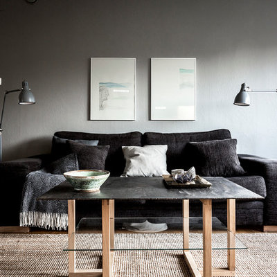 Mid-sized danish formal dark wood floor living room photo in Stockholm with gray walls, no fireplace and no tv