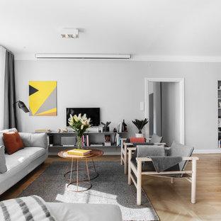 Inspiration för ett mellanstort skandinaviskt vardagsrum, med vita väggar, mellanmörkt trägolv, en fristående TV och beiget golv