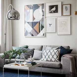 Inspiration for a scandinavian light wood floor and beige floor living room remodel in Stockholm with white walls