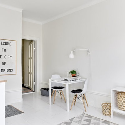 Living room - mid-sized scandinavian open concept and formal painted wood floor living room idea in Stockholm with white walls, no fireplace and no tv
