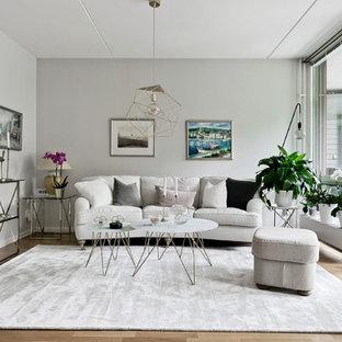 Inspiration för nordiska vardagsrum, med ett finrum, grå väggar, ljust trägolv och beiget golv