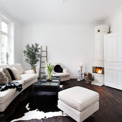 Danish formal and open concept dark wood floor living room photo in Malmo with white walls, a corner fireplace and no tv