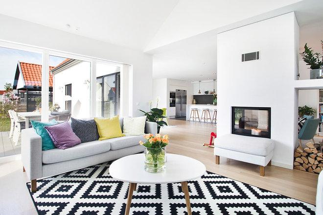 Scandinavian Living Room by helsingHouse Fastighetsmäklare