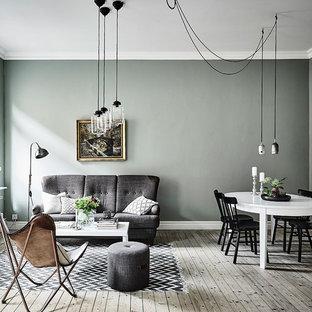 Idee per un grande soggiorno scandinavo aperto con sala formale, pareti verdi, parquet chiaro, nessun camino e nessuna TV