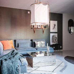 Inredning av ett skandinaviskt vardagsrum, med grå väggar och grått golv
