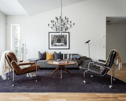 photos et id es d co de pi ces vivre scandinaves avec un mur gris. Black Bedroom Furniture Sets. Home Design Ideas