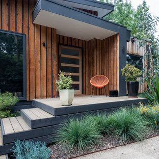 Inspiration for a contemporary verandah in Melbourne with decking and a roof extension.