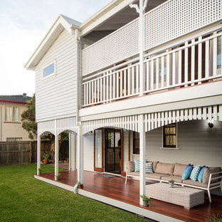 Inspiration for a beach style backyard verandah in Brisbane with decking and a roof extension.