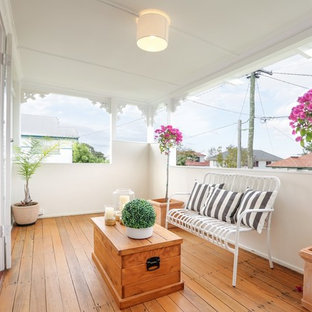 Small scandinavian verandah in Brisbane with a roof extension and decking.
