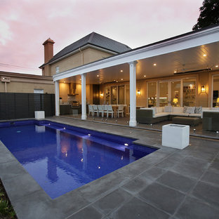 Design ideas for a large mediterranean back veranda in Adelaide with an outdoor kitchen, concrete paving and a roof extension.