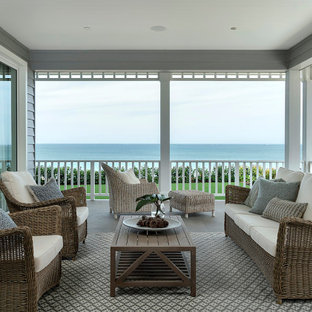 Design ideas for a large transitional backyard verandah in Perth with tile and a roof extension.