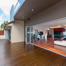 Contemporary Porch by SEQ Building Design