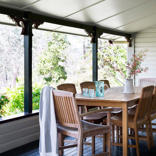 Inspiration for a country verandah in Brisbane with decking and a roof extension.
