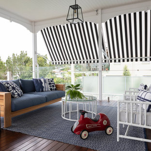 Mid-sized transitional backyard verandah in Brisbane with decking and a roof extension.