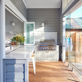 Photo of a transitional verandah in Sydney with an outdoor kitchen, decking and a roof extension.